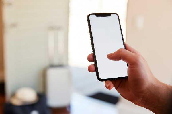 man using phone on app